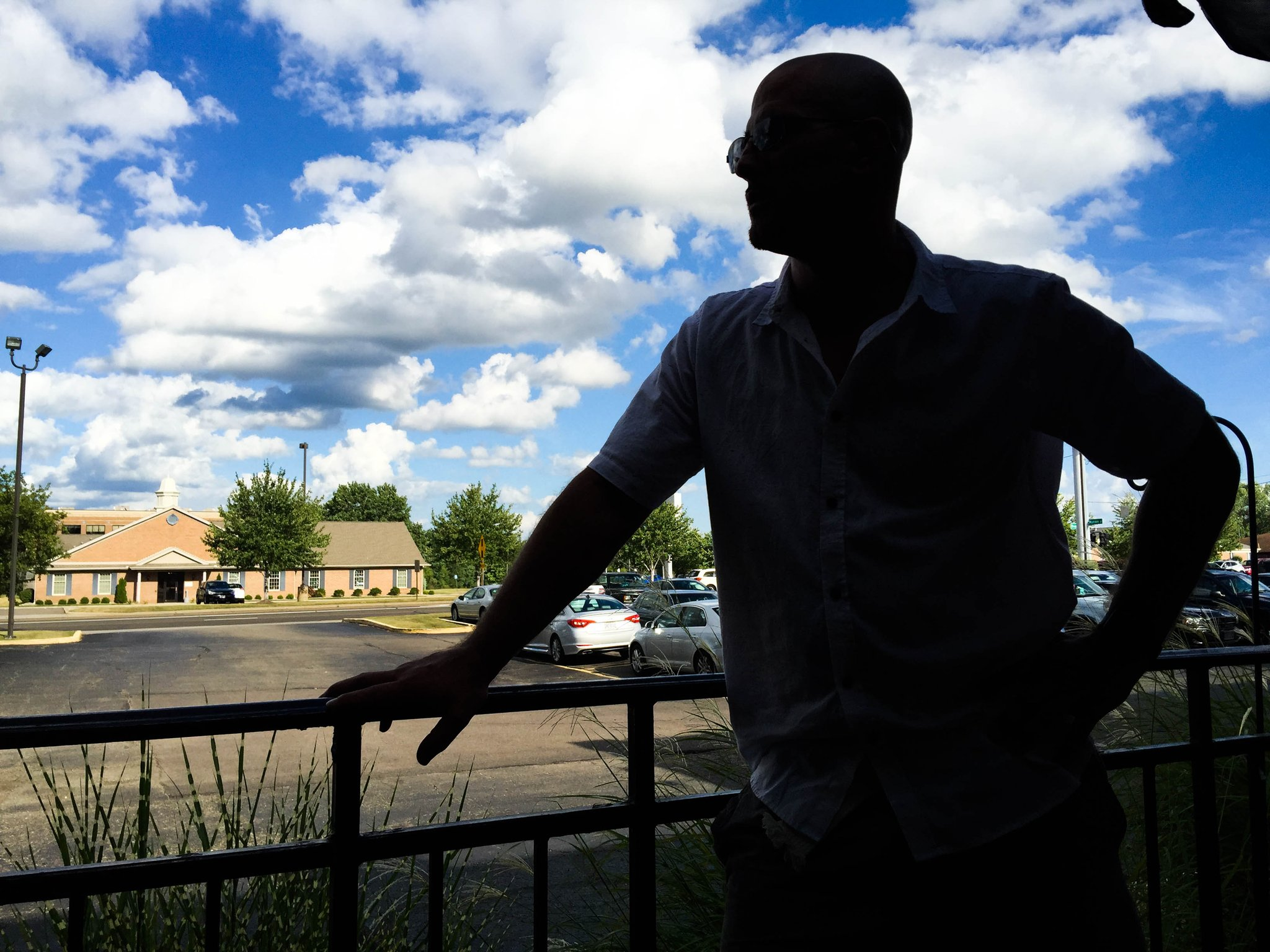 *Andrew, 37, looks out from the patio at a restaurant in Canton, Ohio on Aug. 18. (Photo by Stephanie Haney)